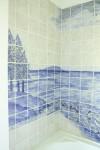 Hand painted custom tile bath tub surround